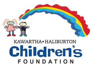 Kawartha-Haliburton Children's Foundation logo children's drawing with two children holding hands one wearing pink, one wearing black, both beside a colourful rainbow. Text below reads Kawartha-Haliburton Children's Foundation.